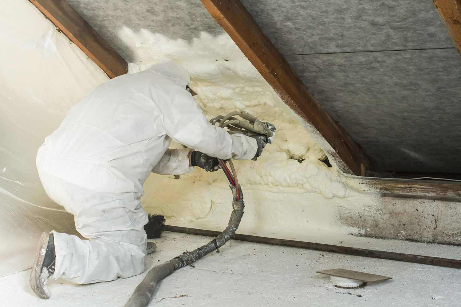 Man Is Spraying With Liquid Insulating Foam In A Home In Lethbridge, Alberta